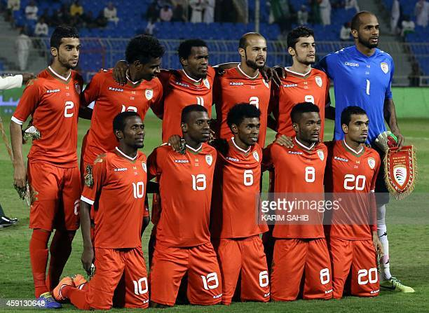 The Omani national football team poses for a family picture before their match against Iraq for the Gulf Cup Group B at the Prince Faisal bin Fahad...