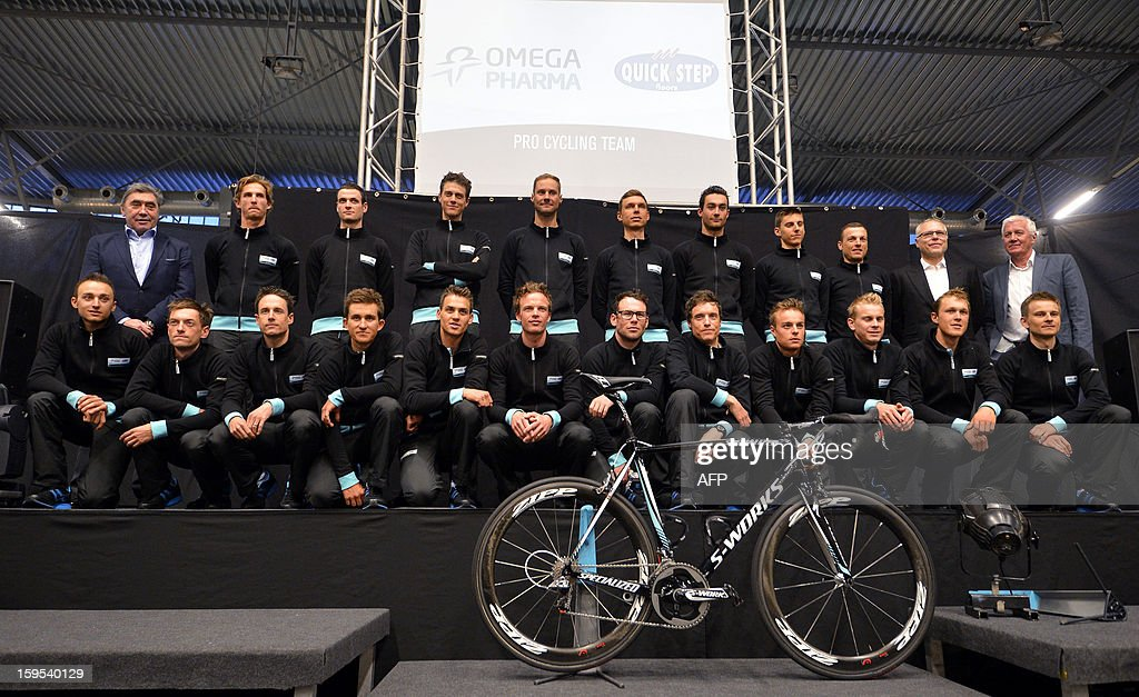 The Omega Pharma - Quick Step riders and staff members, with former Belgian cyclist Eddy Merckx (L, upper), Belgian national champion Tom Boonen (C, upper), Czech businessman and team owner Zdenek Bakala (2ndR, upper), Belgian General manager Patrick Lefevere (R, upper), Belgian Iljo Keisse (CL, lower), British Mark Cavendish (C, lower) and France's Sylvain Chavanel (CR, lower) pose at the team presentation of Belgian cycling team Omega Pharma - Quick Step at the 'Vlaams Wielercentrum Eddy Merckx' in Gent on January 15, 2013.