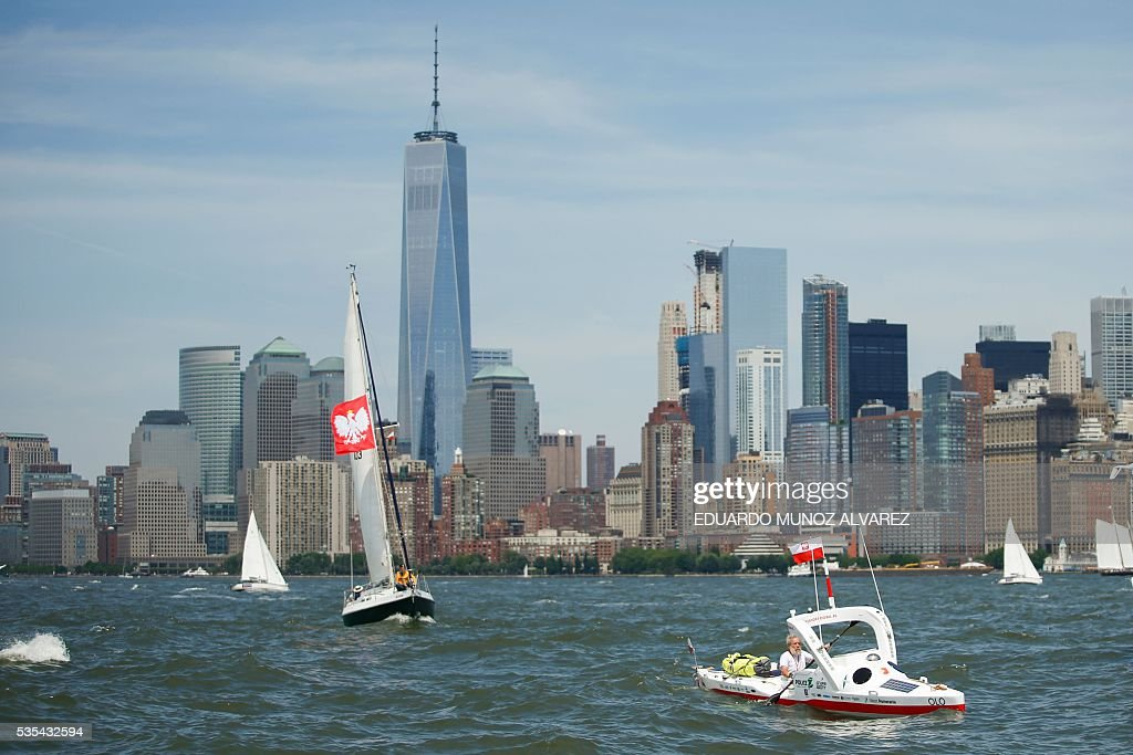 The One World Trade center is seen at the background as Polish kayaker Aleksander Doba sails during the start of his translatlantic kayak adventure from New York to Lisbon on May 29, 2016 in New York. Doba says this will be his toughest challenge yet, but that he feels like a young man and 'will not pretend to be old.' / AFP / EDUARDO