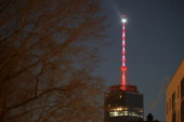 The One World Trade Center spire glows orange for the Denver Bronco's on January 30 2014 in New York City The spire alternated with with Bronco's...