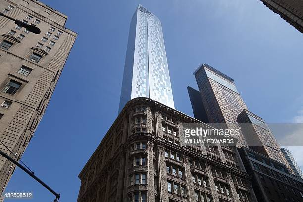 The One57 skyscraper looms above the Alwyn Court apartment building on June 16 2015 in Midtown Manhattan in New York Super tall super skinny and...