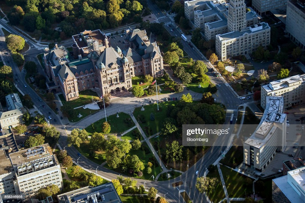 The Ontario Legislative Building stands in Queens Park in this aerial photograph taken above Toronto, Ontario, Canada, on Monday, Oct. 2, 2017. Toronto housing prices fell for a fourth month in September as sales remained sluggish, particularly in the detached-home segment that has borne the brunt of the correction in Canada's biggest city. Photographer: James MacDonald/Bloomberg via Getty Images