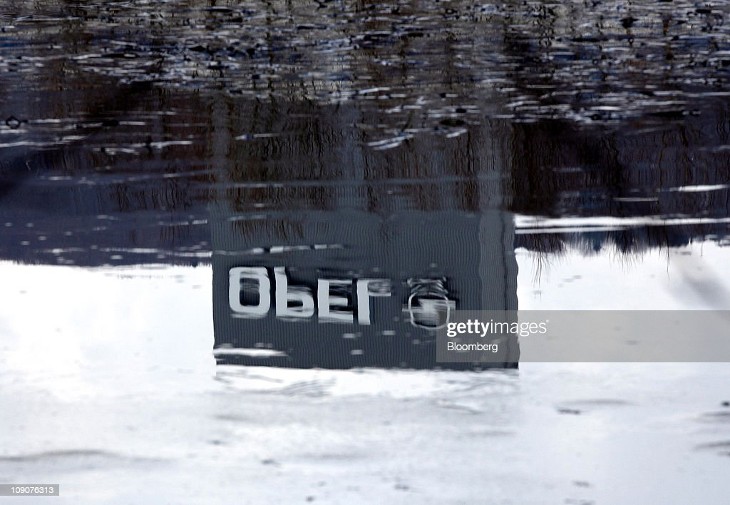 The Opel company logo is reflected in rain water outside the General Motor Co.'s Adam Opel plant in Eisenach, Germany, on Friday, Feb.11, 2011. General Motors Co.'s Opel unit may break even this year, excluding restructuring costs, said Nick Reilly, GM's European chief. Photographer: Jochen Eckel/Bloomberg via Getty Images