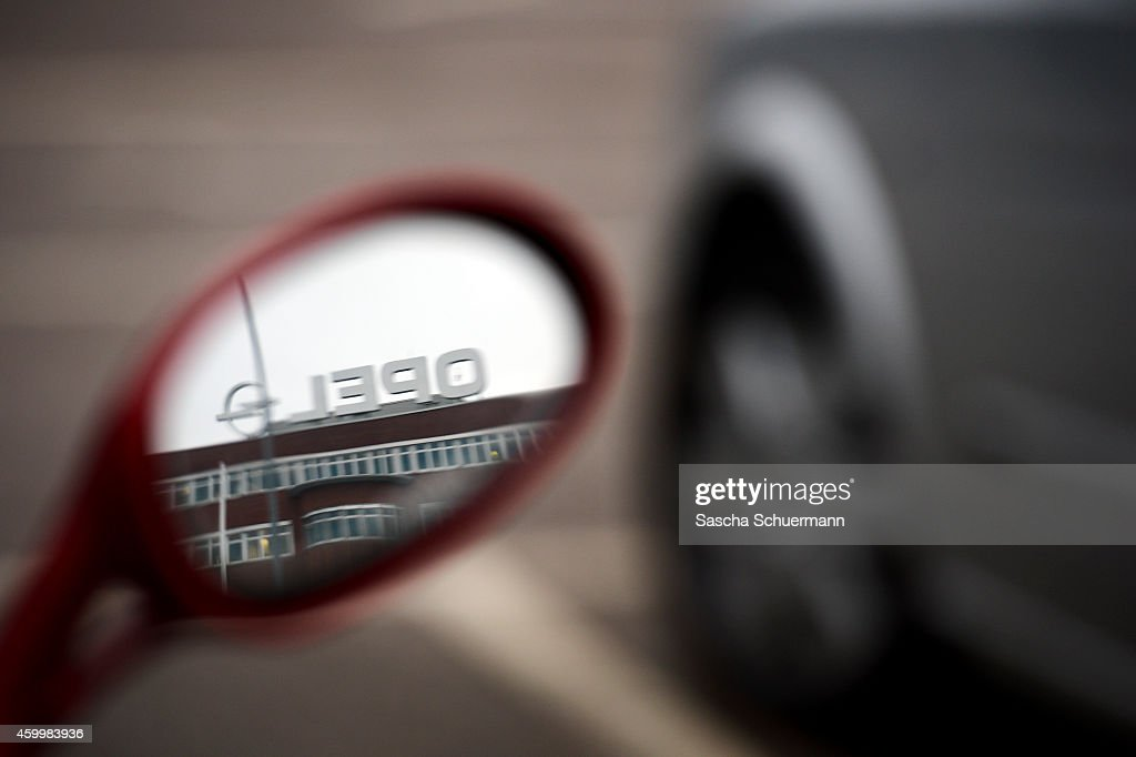 The Opel logo is reflected in the rear view mirror of a motorcycle on December 5 2014 in Bochum Germany Bochum's Opel car factory is closing after 52...