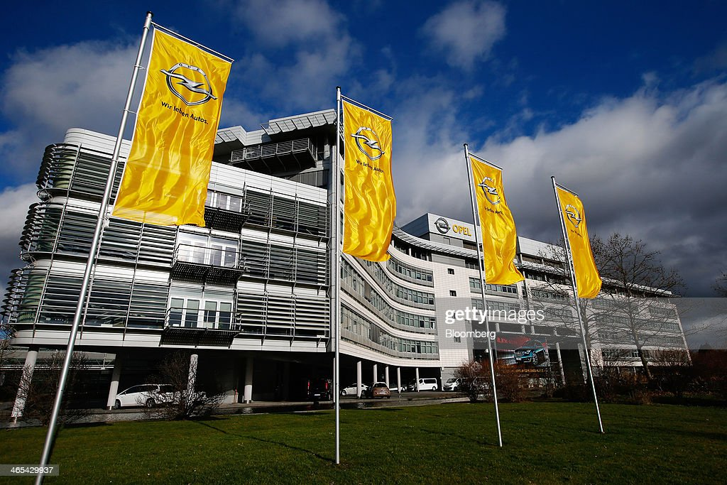The Opel logo sits on banners flying outside General Motors Co's Opel unit headquarters in Ruesselsheim Germany on Monday Jan 27 2014 GM is sticking...