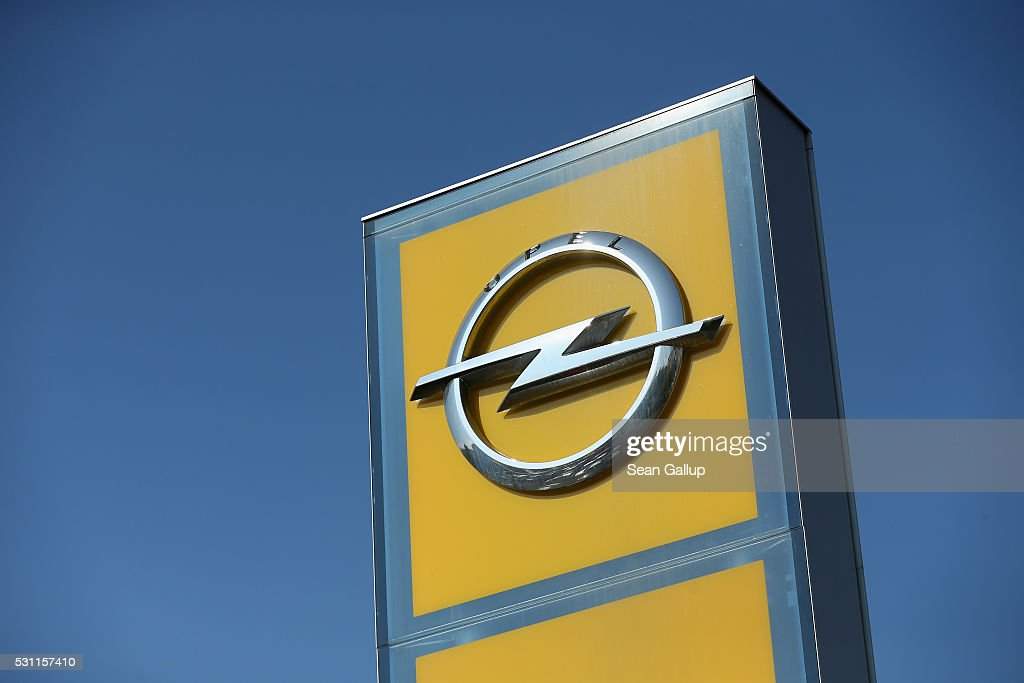 The Opel logo stands at an Adam Opel car dealership on May 13 2016 in Berlin Germany A German environmental group Deutsche Umwelthilfe in cooperation...