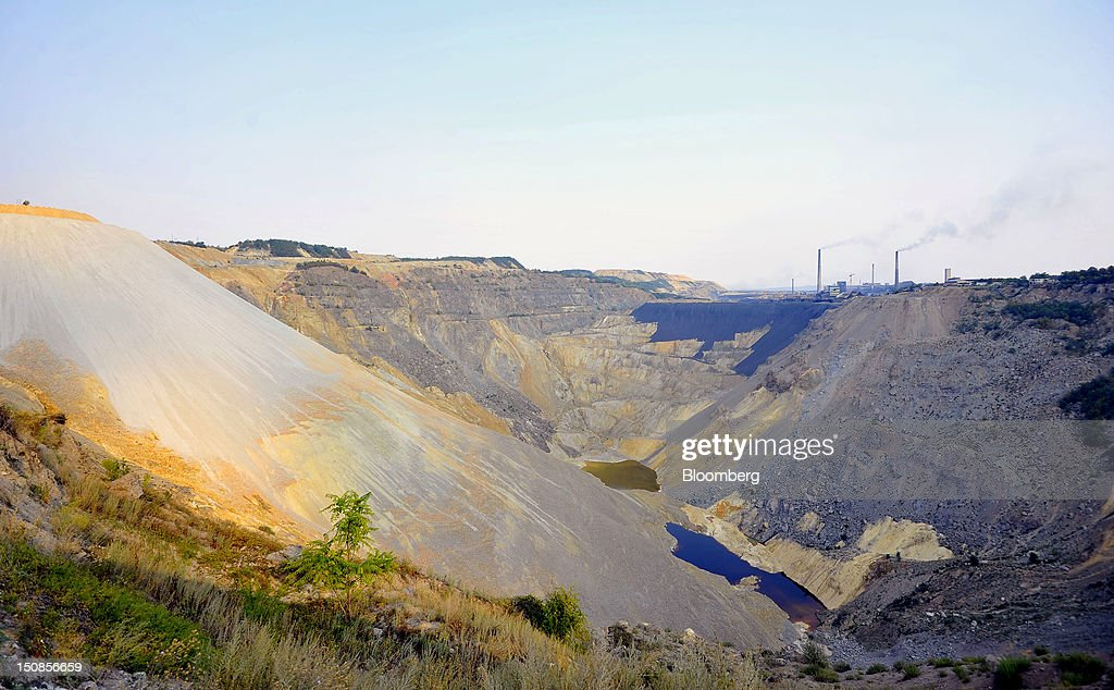 The open cast mining pit and smelter is seen at the copper mining and smelting complex, operated by RTB Bor Group, in Bor, Serbia, on Friday, Aug. 24, 2012. Copper neared a one-week low in London on signs Asian economies are slowing and speculation that U.S. policy makers will refrain from a fresh round of stimulus. Photographer: Oliver Bunic/Bloomberg via Getty Images