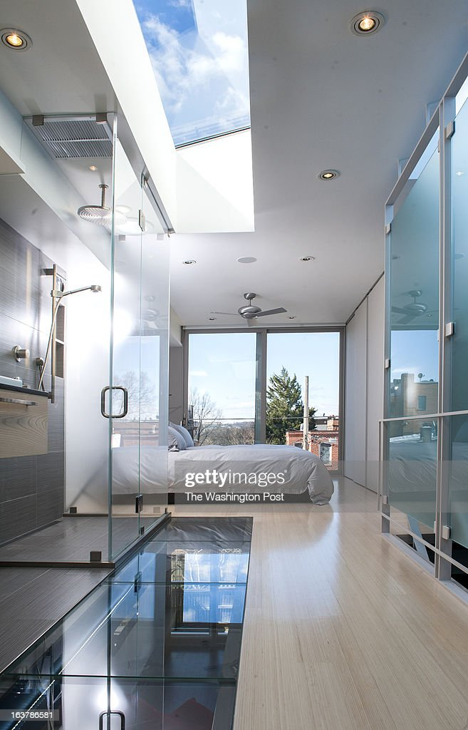The open floor plan shows the shower that is open to the bedroom and the skylight that allows light to travel through the glass panel of the bathroom floor to the next level Thursday March 7, 2013 in Washington, DC.