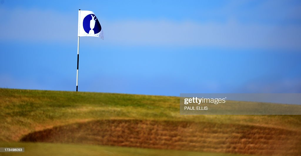 The Open Golf Championship logo is displayed on a flag at Muirfield golf course at Gullane in Scotland on July 15, 2013 ahead of The 2013 Open Golf Championship.
