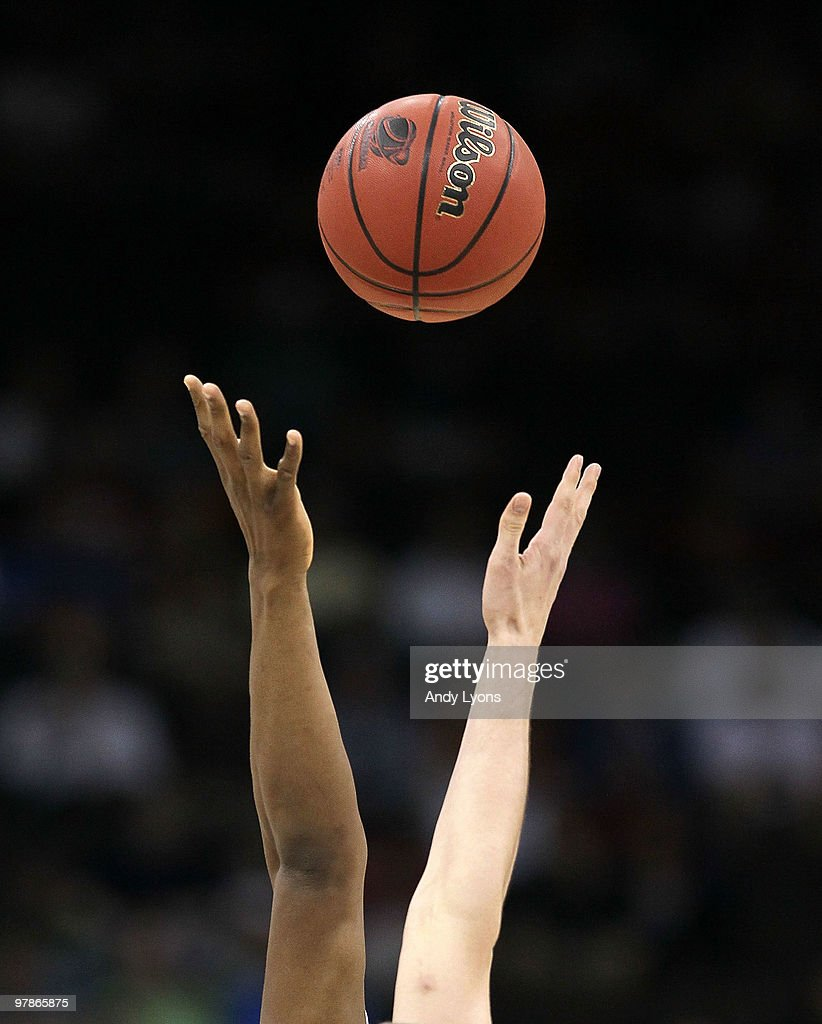 The opening jump ball of the Temple Owls game against the Cornell Big Red during the first round of the 2010 NCAA men's basketball tournament at...