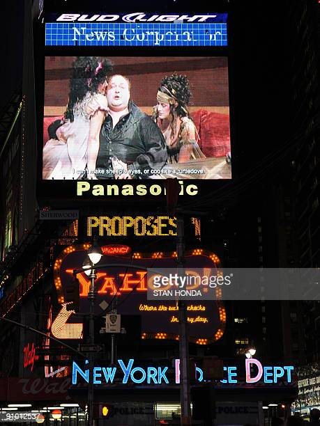 The opening night performance of Puccini�s classic opera Tosca by the Metropolitan Opera is shown September 21 2009 on a big television screen in New...