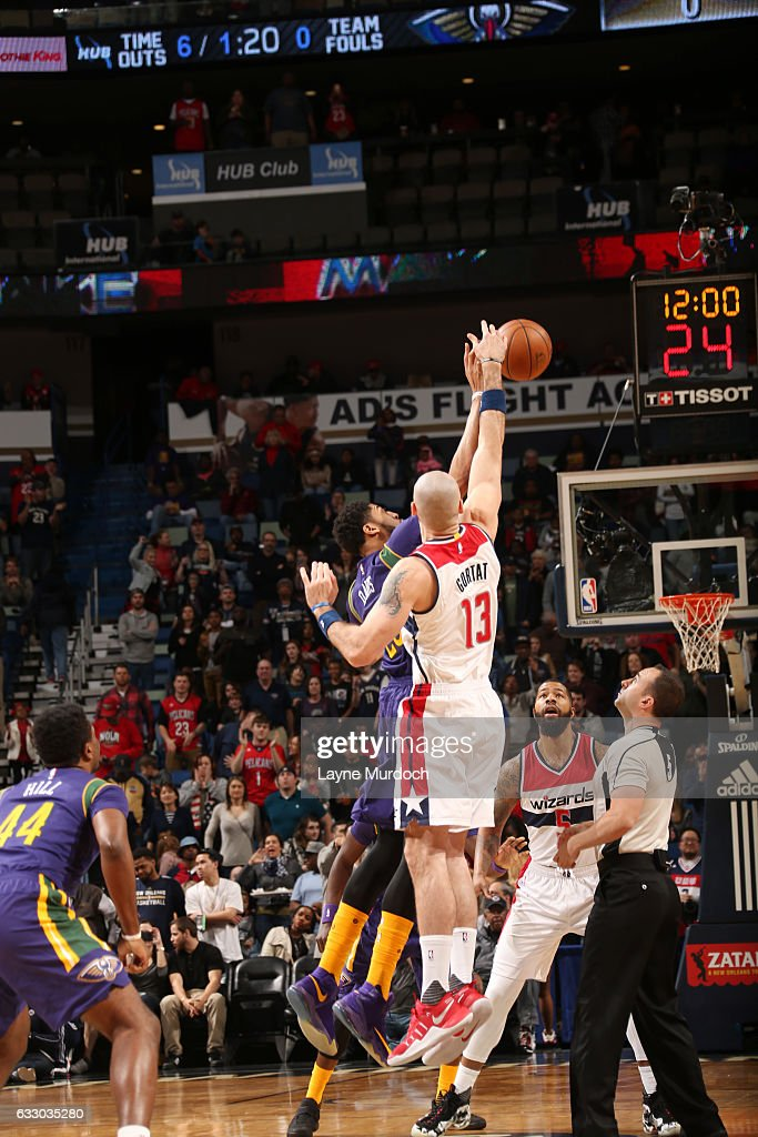 The opening tip off begins between Marcin Gortat #13 of the Washington Wizards and Anthony Davis #23 of the New Orleans Pelicans during the game on January 29, 2017 at Smoothie King Center in New Orleans, Louisiana.