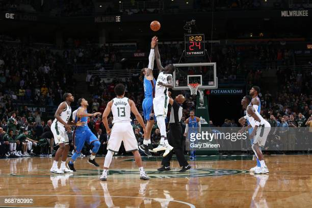 The opening tip off begins between Thon Maker of the Milwaukee Bucks and Steven Adams of the Oklahoma City Thunder on October 31 2017 at the BMO...