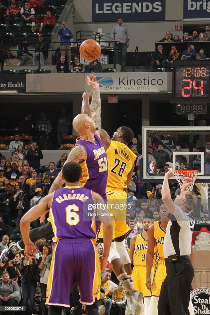 The opening tip off between <a gi-track='captionPersonalityLinkClicked' href=/galleries/search?phrase=Robert+Sacre&family=editorial&specificpeople=4682421 ng-click='$event.stopPropagation()'>Robert Sacre</a> #50 of the Los Angeles Lakers and <a gi-track='captionPersonalityLinkClicked' href=/galleries/search?phrase=Ian+Mahinmi&family=editorial&specificpeople=740196 ng-click='$event.stopPropagation()'>Ian Mahinmi</a> #28 of the Indiana Pacers on February 8, 2016 at Bankers Life Fieldhouse in Indianapolis, Indiana.