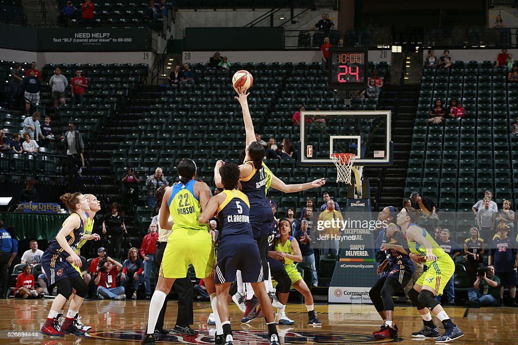 The opening tip off between the Indiana Fever and the Dallas Wings during a preseason game on May 1, 2016 at Bankers Life Fieldhouse in Indianapolis, Indiana.