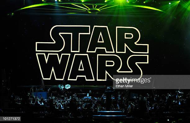 The opening title from the Star Wars film series is shown on screen while musicians perform during 'Star Wars In Concert' at the Orleans Arena May 29...
