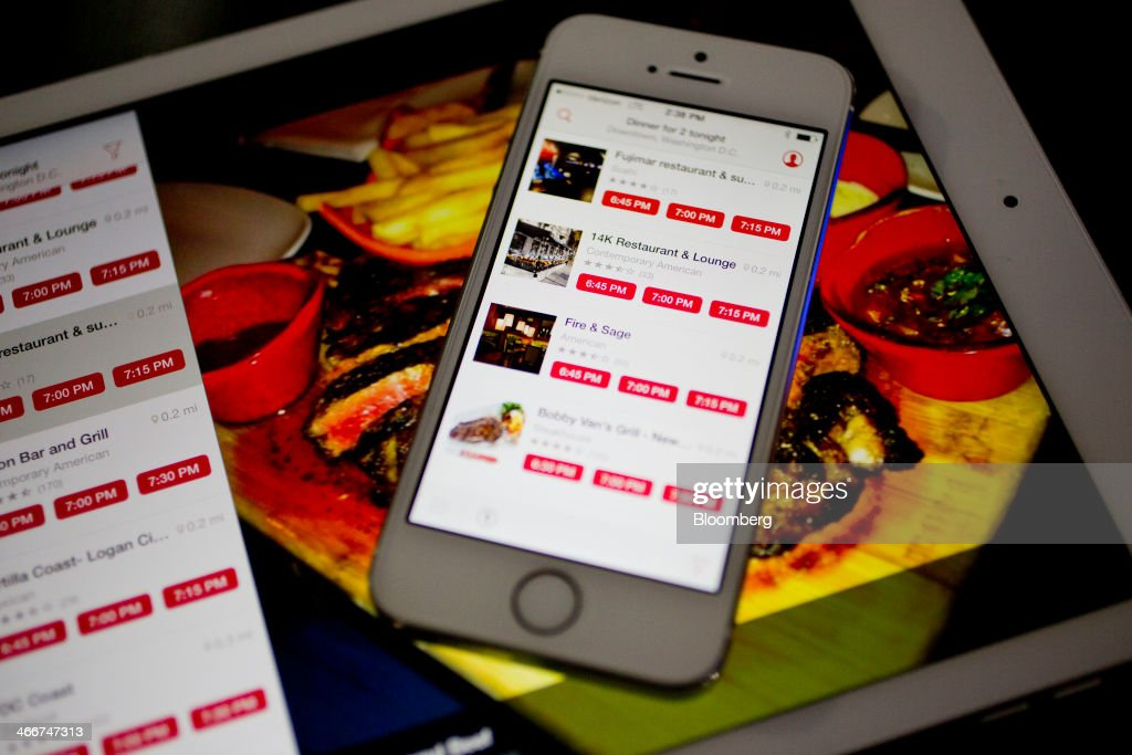 The OpenTable Inc. application is displayed on an Apple Inc. iPad Air and iPhone 5s in this arranged photograph in Washington, D.C., U.S., on Monday, Feb. 3, 2014. OpenTable Inc. is expected to release earnings data on Feb. 6. Photographer: Andrew Harrer/Bloomberg via Getty Images