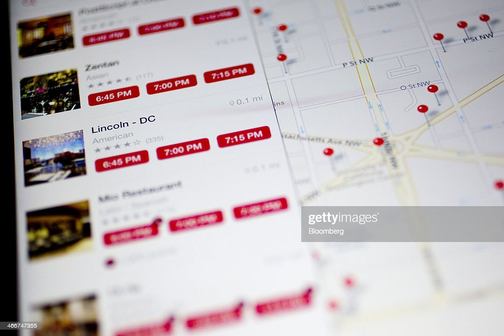 The OpenTable Inc. application is displayed on an Apple Inc. iPad Air in this arranged photograph in Washington, D.C., U.S., on Monday, Feb. 3, 2014. OpenTable Inc. is expected to release earnings data on Feb. 6. Photographer: Andrew Harrer/Bloomberg via Getty Images