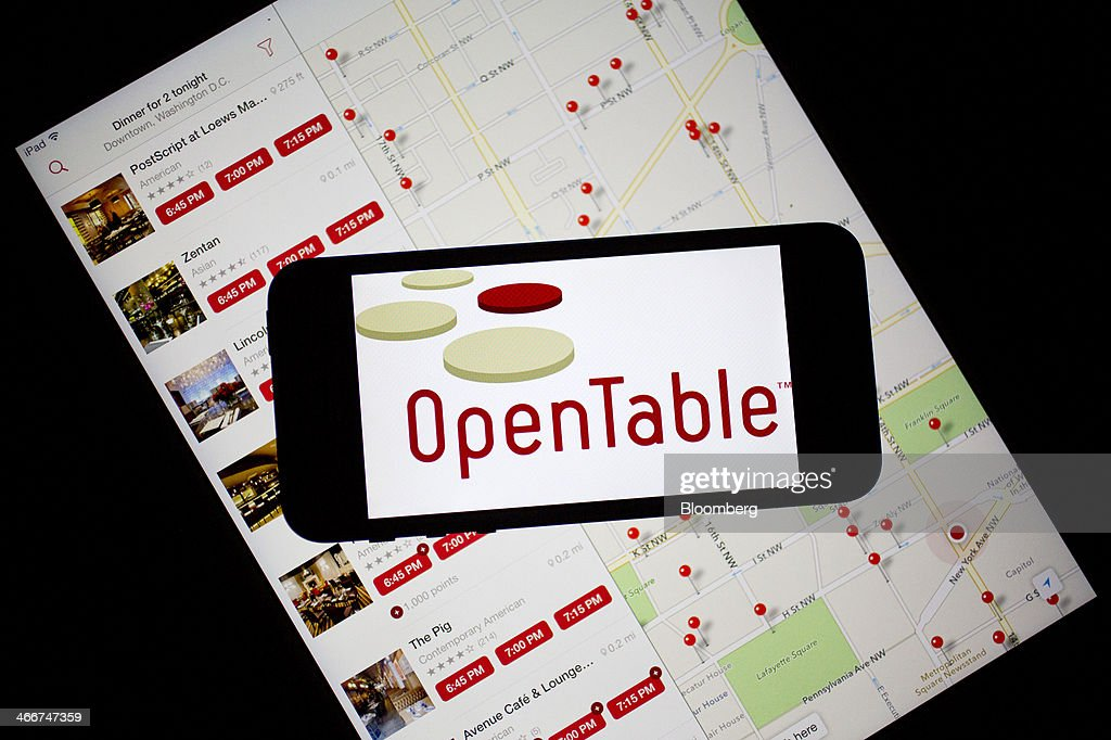 The OpenTable Inc. logo and application are displayed on an Apple Inc. iPhone 5s and iPad Air in this arranged photograph in Washington, D.C., U.S., on Monday, Feb. 3, 2014. OpenTable Inc. is expected to release earnings data on Feb. 6. Photographer: Andrew Harrer/Bloomberg via Getty Images