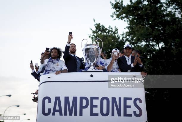 The opentop Real Madrid bus arrives as Real Madrid players take selfies at Cibeles Square during celebrations at Cibeles Fountain after winning the...