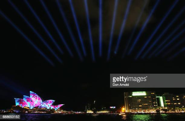 The Opera House sails and surrounding areas are seen lit up on May 26 2017 in Sydney Australia Vivid Sydney is an annual festival that features light...