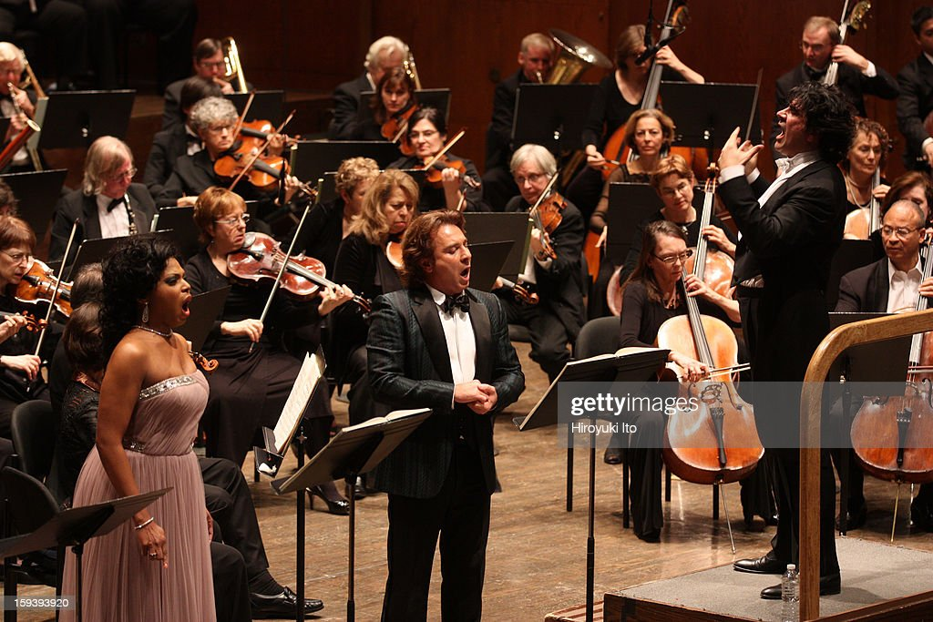 The Opera Orchestra of New York performing Umberto Giordano's 'Andrea Chenier' on Sunday afternoon, January 6, 2013.This image:From left, Kristin Lewis, <a gi-track='captionPersonalityLinkClicked' href=/galleries/search?phrase=Roberto+Alagna&family=editorial&specificpeople=679931 ng-click='$event.stopPropagation()'>Roberto Alagna</a> and the conductor Alberto Veronesi.