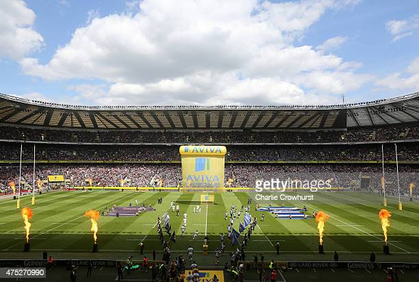 The opposing teams run out onto the pitch prior to kickoff during the Aviva Premiership Final between Bath Rugby and Saracens at Twickenham Stadium...