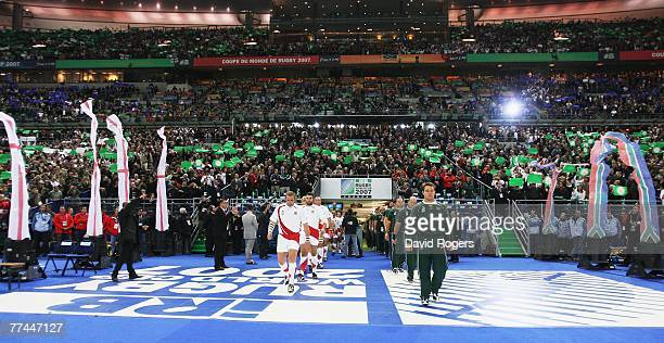 The opposing teams walk out onto the pitch prior to kickoff during the 2007 Rugby World Cup Final between England and South Africa at the Stade de...