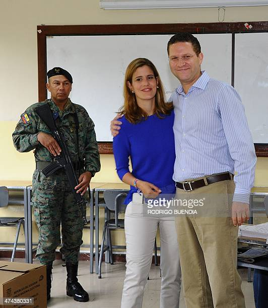 The opposition candidate for Quito's Mayor's Office Mauricio Rodas accompanied by his wife Maria Fernanda Pacheco poses after casting his vote at a...