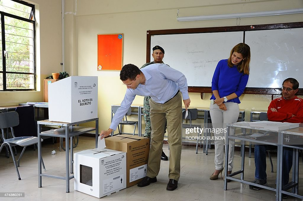 The opposition candidate for Quito's Mayor's Office, Mauricio Rodas, casts his vote at a polling station in northern Quito, as Ecuador holds municipal elections on February 23, 2014.