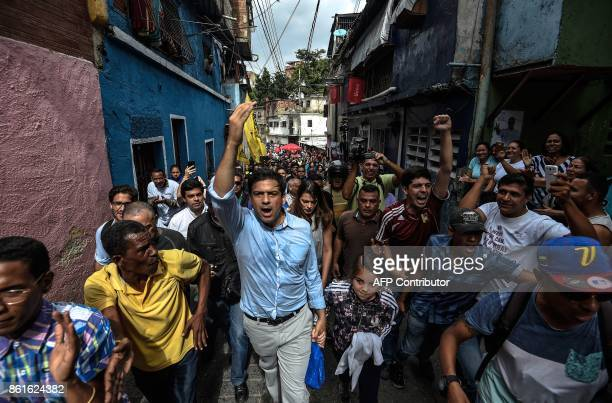 TOPSHOT The opposition's candidate for governor for the state of Miranda Mayor of Caracas' Sucre Municipality Carlos Ocariz greets supporters as...