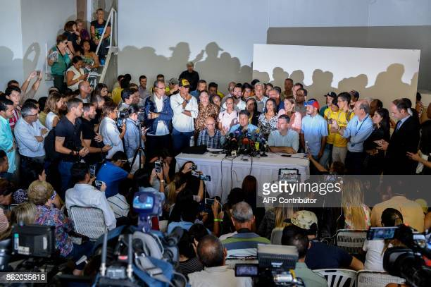 The opposition's candidate for governor for the state of Miranda Mayor of Caracas' Sucre Municipality Carlos Ocariz offers a press conference in...