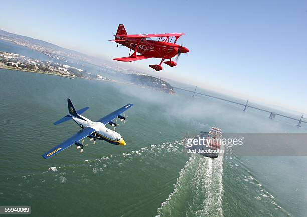 The 'Oracle Challenger' piloted by Sean D Tucker flies near the Blue Angel 'Fat Albert' C130 plane piloted by Major Kenneth Asbridge and his all...