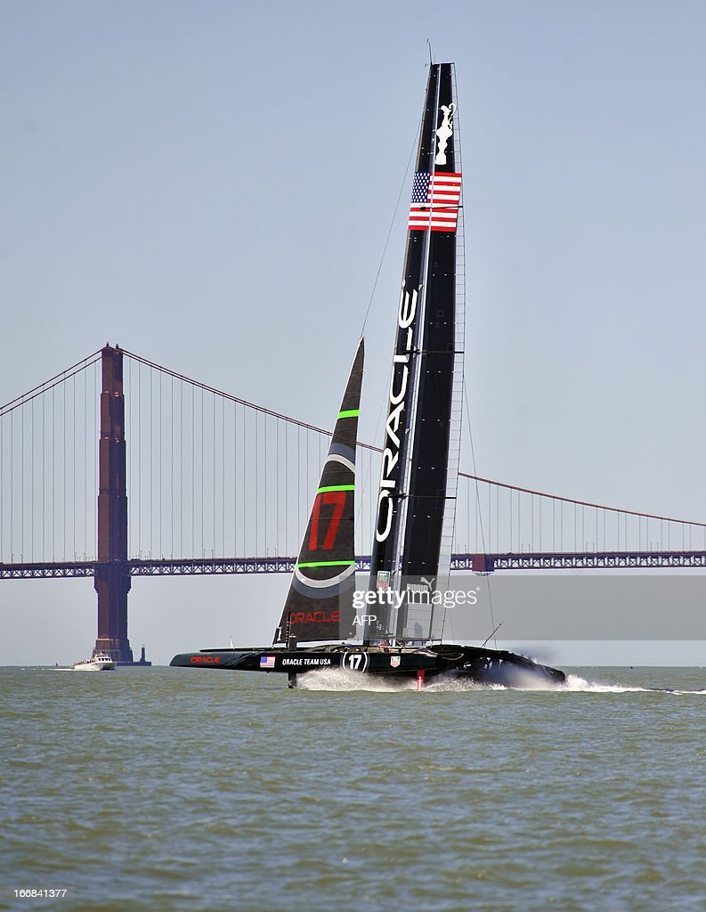 The Oracle team sails by Golden Gate Bridge in their AC-72 yacht in San Francisco Bay on April 17, 2013 in California. The team is training for the 2013 America's Cup to be held September 7 to 22 in San Francisco. AFP PHOTO/Josh Edelson