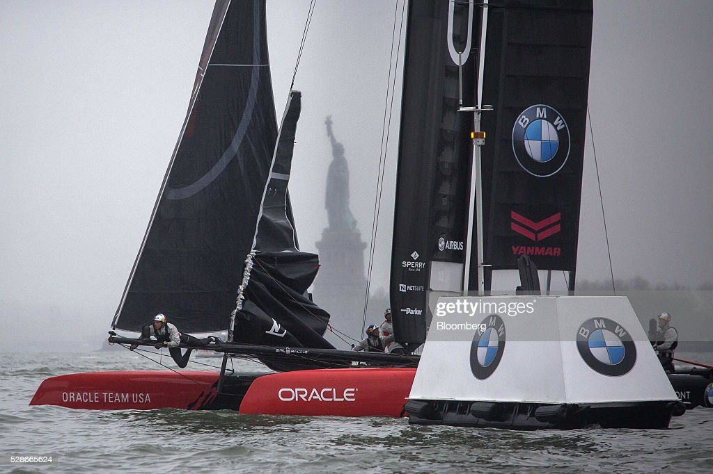The Oracle Team USA catamaran sails past the Statue of Liberty during practice for the Louis Vuitton America's Cup World Series sailing races in New York, U.S., on Friday, May 6, 2016. The America's Cup sailing races are held in New York City on the Hudson River for the first time since 1920. Photographer: Michael Nagle/Bloomberg via Getty Images