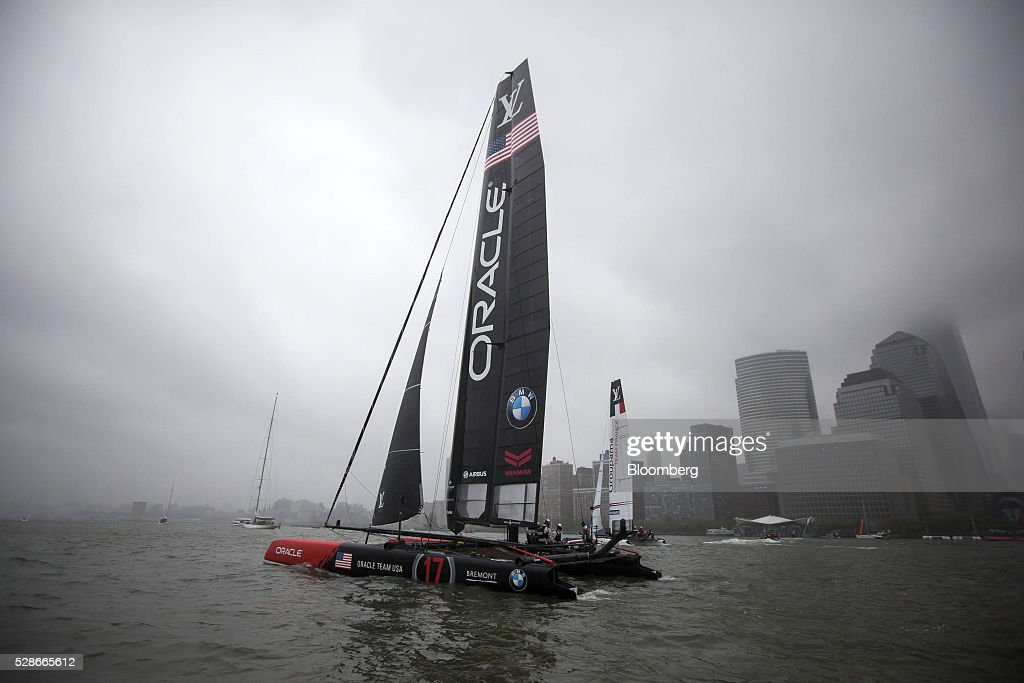The Oracle Team USA, left, and Groupama Team France, right, catamarans sail during practice for the Louis Vuitton America's Cup World Series sailing races in New York, U.S., on Friday, May 6, 2016. The America's Cup sailing races are held in New York City on the Hudson River for the first time since 1920. Photographer: Michael Nagle/Bloomberg via Getty Images
