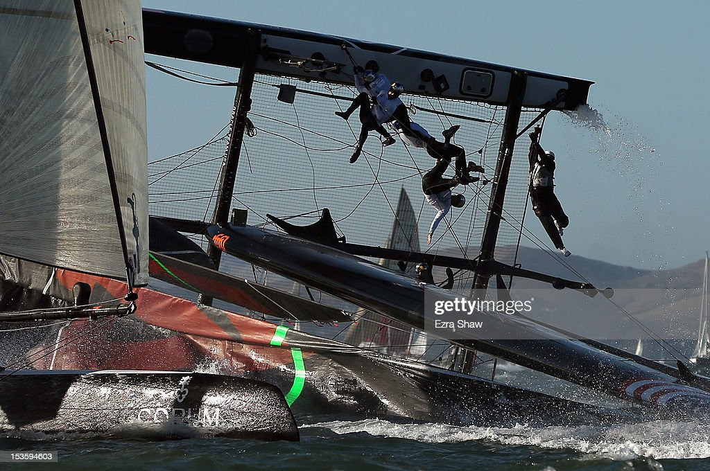 The Oracle Team USA skippered by James Spithill flips over during a fleet race in the America's Cup World Series on October 6 2012 in San Francisco...