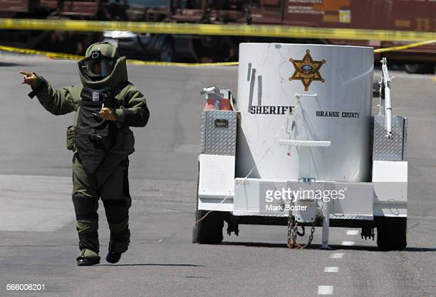 The Orange County Sheriff Bomb Squad works to dispose of a cache of explosives discovered in a backpack in a culvert near Lakeview Avenue and...