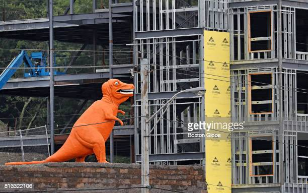 The Orange Dinosaur of Route One Miniature Golf and Batting Cages fame is pictured at its new home high atop a retaining wall overlooking the Essex...