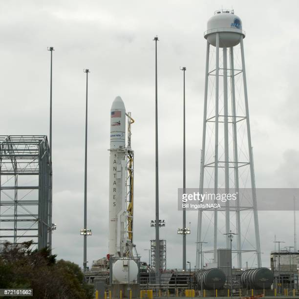 The Orbital ATK Antares rocket with the Cygnus spacecraft onboard is raised into the vertical position on launch Pad0A Thursday November 9 2017 at...