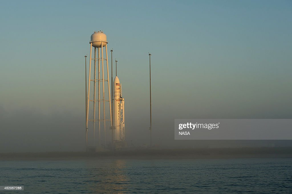 The Orbital Sciences Corporation Antares rocket, with the Cygnus spacecraft onboard, is pictured at sunrise on the launch pad, July 12, 2014, at NASA's Wallops Flight Facility, Wallops Island, Virginia. The Antares will launch with the Cygnus spacecraft filled with over 3,000 pounds of supplies for the International Space Station, including science experiments, experiment hardware, spare parts, and crew provisions.