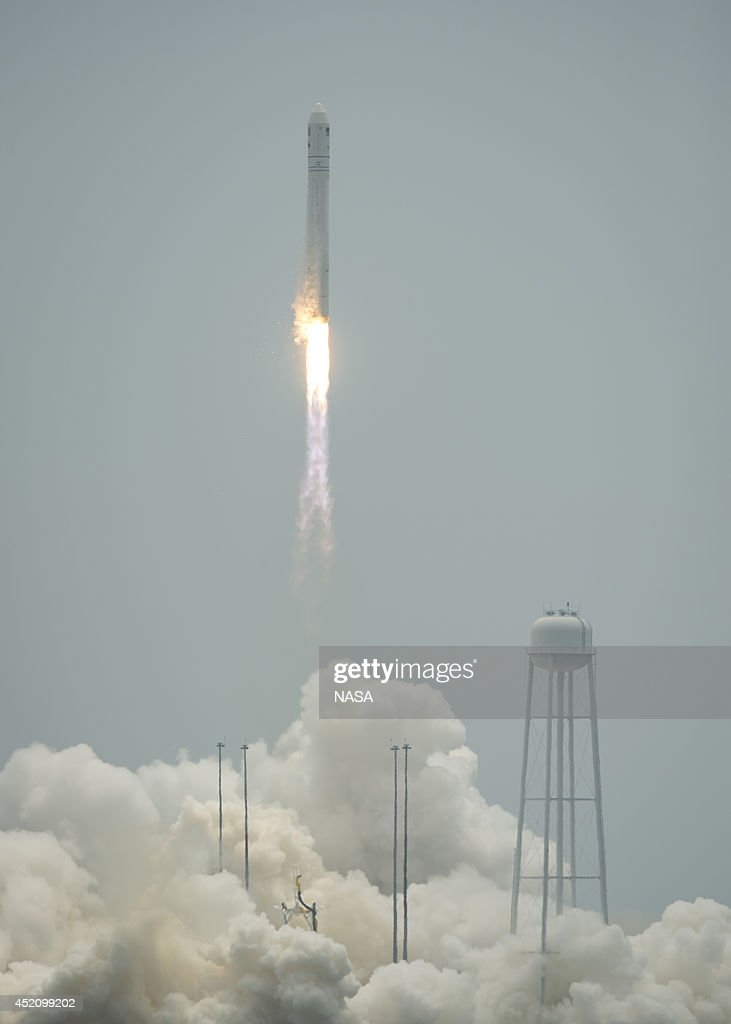 The Orbital Sciences Corporation Antares rocket, with the Cygnus spacecraft onboard, is pictured launching from Pad-0A on July 13, 2014, at NASA's Wallops Flight Facility, Wallops Island, Virginia. The Antares will launch with the Cygnus spacecraft filled with over 3,000 pounds of supplies for the International Space Station, including science experiments, experiment hardware, spare parts, and crew provisions. The Orbital-2 mission is Orbital Sciences' second contracted cargo delivery flight to the space station for NASA.