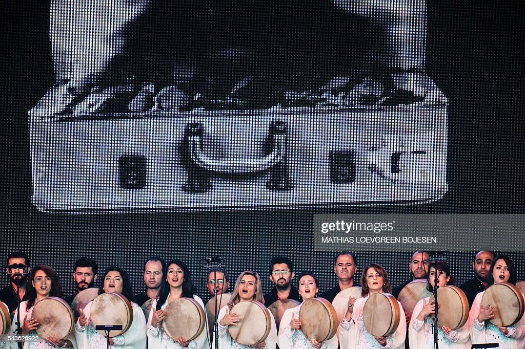 The orchestra of Syrian Musicians and Damon Albarn perform at the Orange stage at the Roslilde festival on June 29, 2016. / AFP / Scanpix / Mathias Loevgreen Bojesen / Denmark OUT
