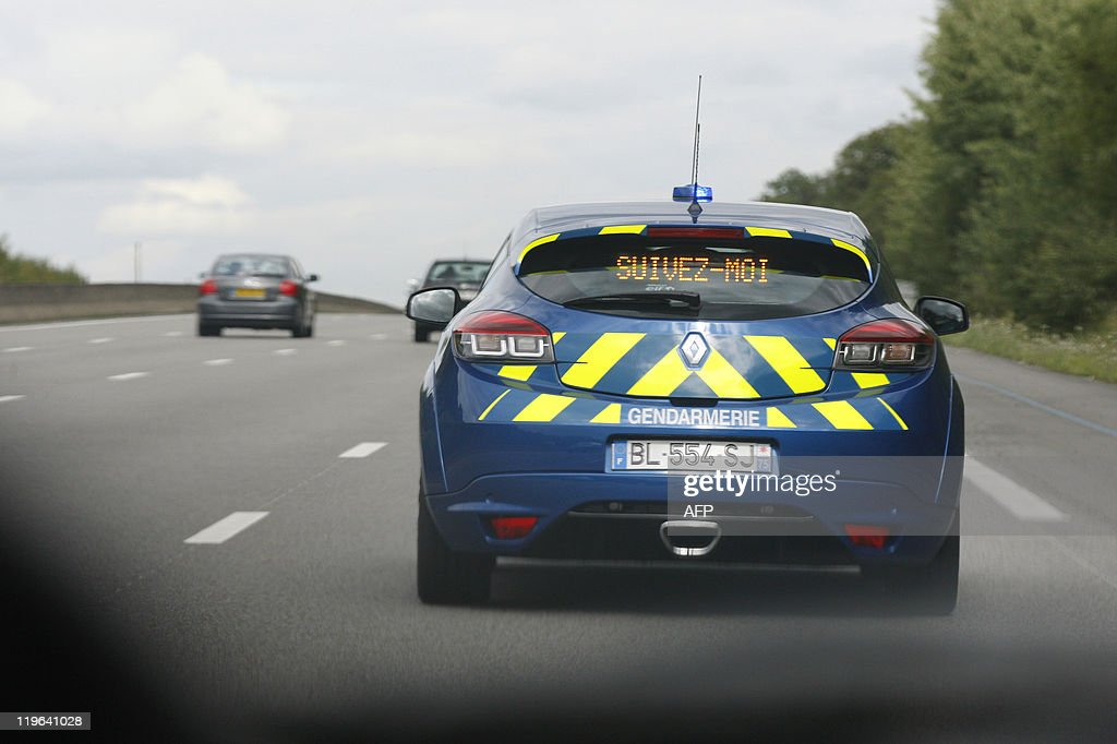The order 'Follow me' appears at the back during a drill by the French Gendarmerie of its new interceptor car, a Megane IIIS, on the motorway between Paris and Saint-Arnoult-en-Yvelines, west of Paris, on July 18, 2011. The car from French car manufacturer Renault, will be used by the Gendarmerie (military police), and will replace progressively their Subaru Impreza.