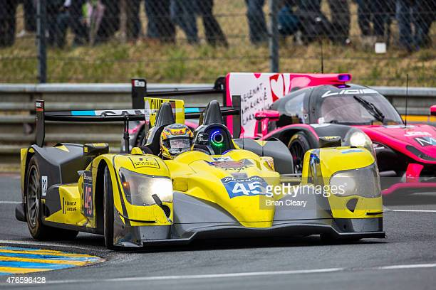 The ORECA 03R Nissan of Jose Ibanez Pierre Perret and Ivan Bellarosa is shown in action in the rain during practice for the 24 Hours of Le Mans on...