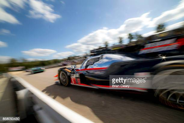 The ORECA LMP2 of Juan Pablo Mntoya of Colombia Helio Castroneves of Brazil and Simon Pagenaud of France drives in the pits during practice at Road...
