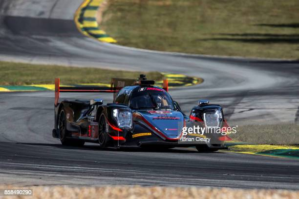 The ORECA LMP2 of Simon Pagenaud of France Helio Castroneves of Brazil and Juan Pablo Montoya of Colombia races on the track during practice for the...