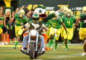 The Oregon Duck mascot enters the stadium on a motorcycle before the game against the Arkansas State Red Wolves on September 1 2012 at Autzen Stadium...