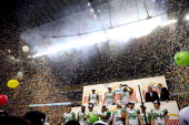 The Oregon Ducks celebrate on stage after defeating the Texas Longhorns 307 in the Valero Alamo Bowl at the Alamodome on December 30 2013 in San...