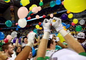 The Oregon Ducks celebrate on the field after defeating the Texas Longhorns 307 in the Valero Alamo Bowl at the Alamodome on December 30 2013 in San...